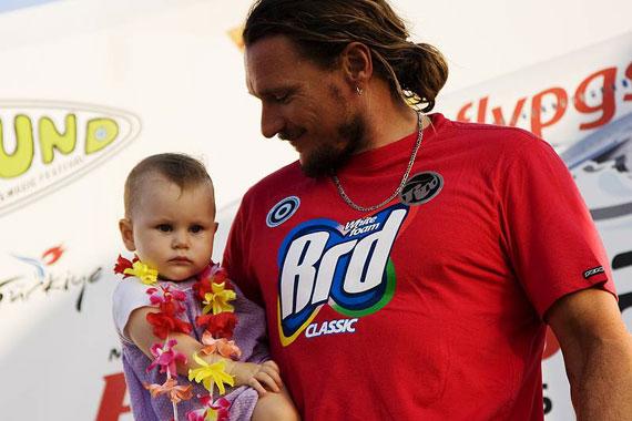 Finian take his daughter on the podium in Alacati - Pic: PWA/ J. Carter