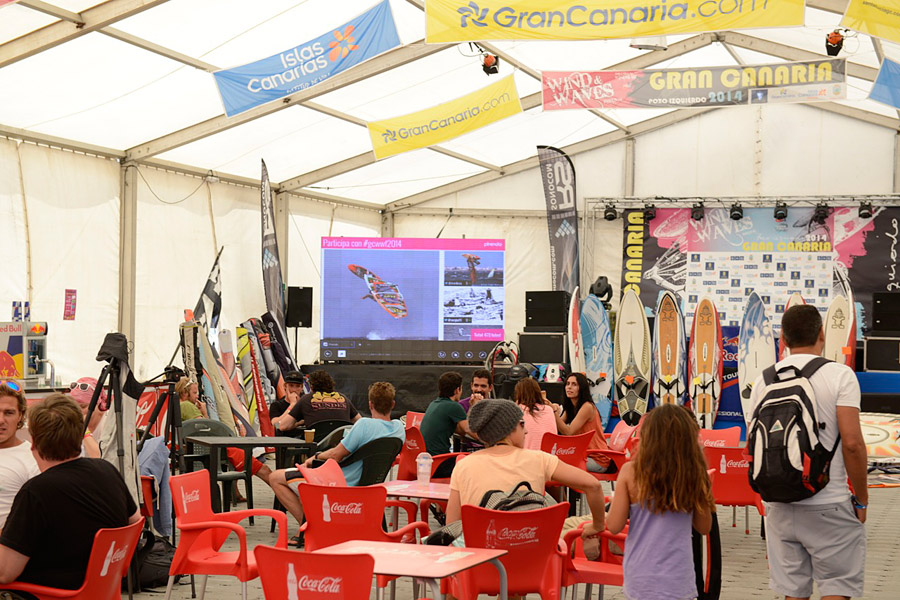 A view inside the tent with a video wall and live action