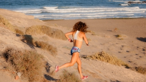 Caterina Stenta has a run at the beach of El Medano (Pic: Roland Bos)