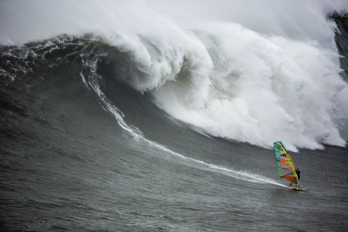 Jason Polakow windsurfs the big wave at Nazare - Pic: Jorge Leal / Red Bull Content Pool