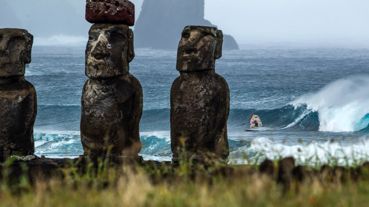 Manu Bouvet in the waves at Easter Island by Pierre Bouras