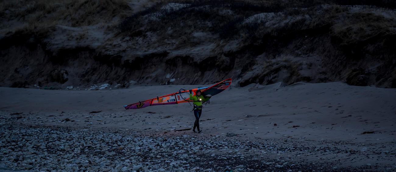Lars Petersen walks along the dark Danish beach (Photo: Mark Wengler)