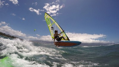 Dax Barker jumps over a wave on Maui