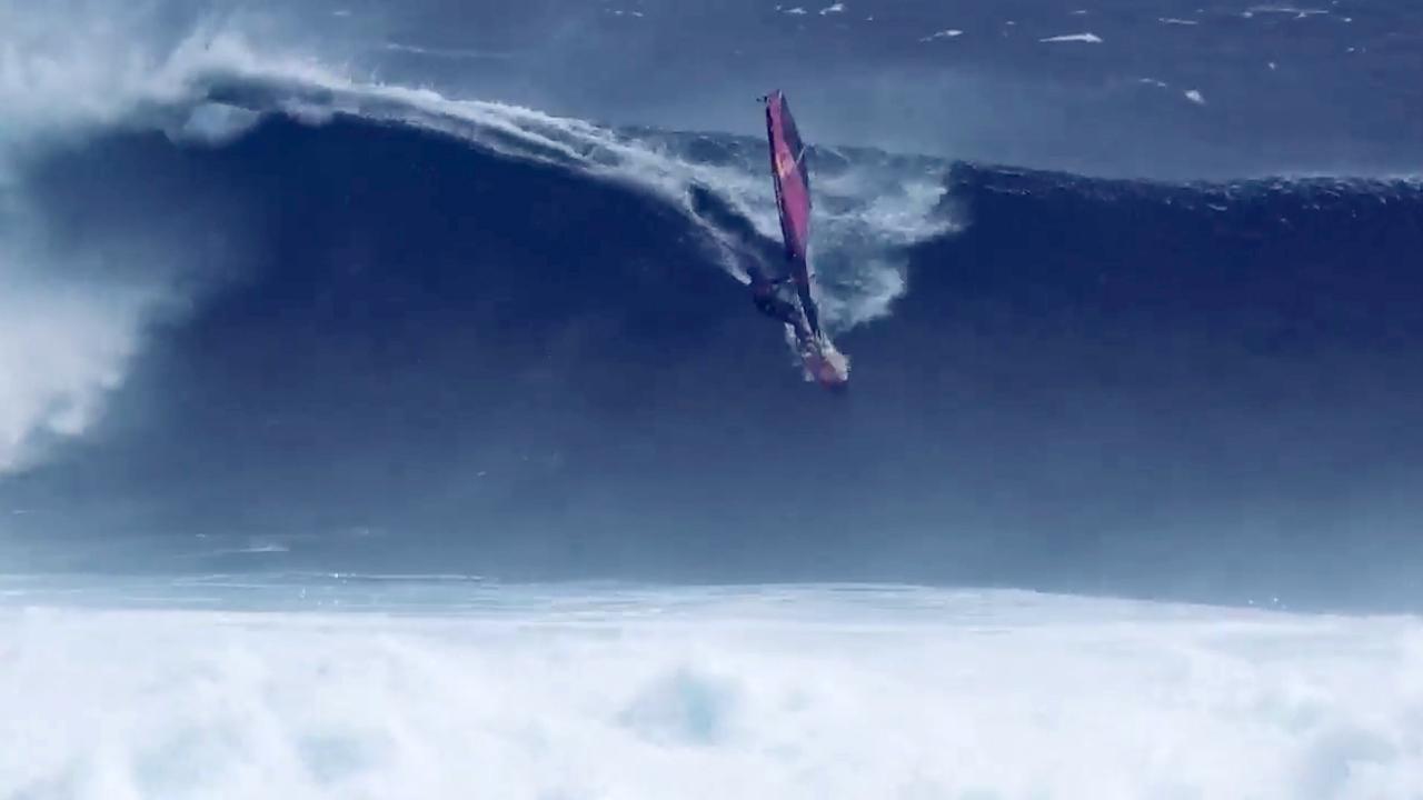 Robby Naish rides at Cloudbreak, Fiji