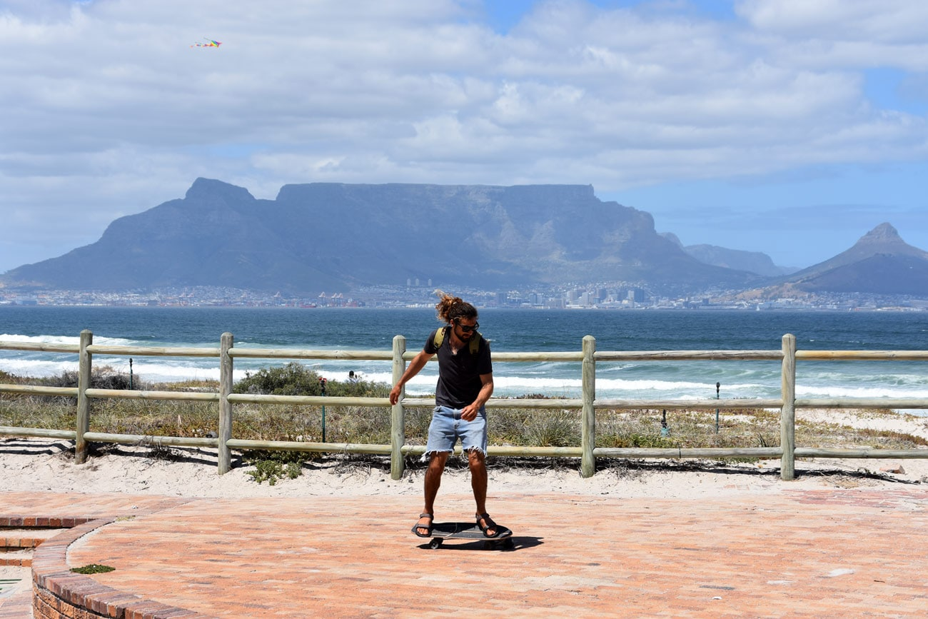 Dudu Levi on his Skateboard just in front of the famous tTable Mountain in Cape Town