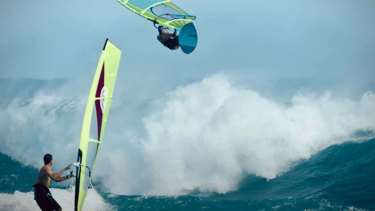 Robby Swift and Marcilio Browne ride waves at Diamond Head in summer 2021